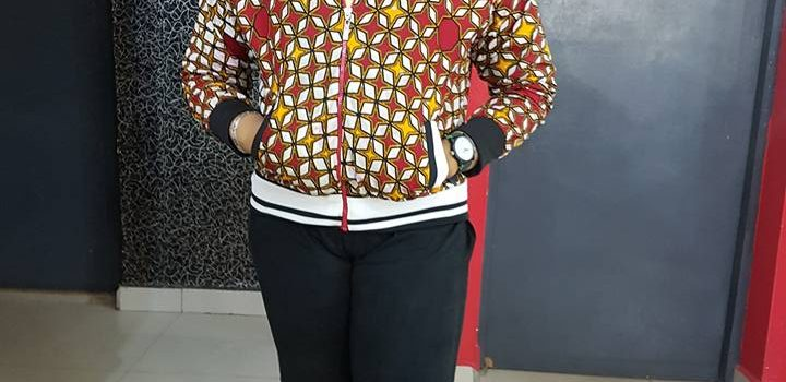 Learn to make this Ankara Varsity Jacket, install the sewing tutorial app